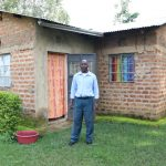 The Water Project: Emachembe Community, Hosea Spring -  Henry In Front Of His House