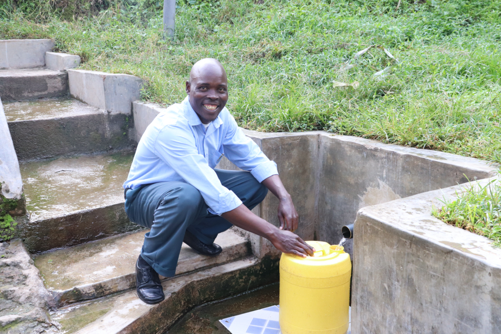 The Water Project : covid19-kenya18145-henry-smiles-while-fetching-water
