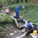 The Water Project: Emachembe Community, Hosea Spring -  Social Distancing At Hosea Spring