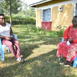 The Water Project: Ibinzo Community, Lucia Spring -  Jacky Sits With Violet After The Interview
