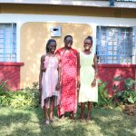 The Water Project: Ibinzo Community, Lucia Spring -  Violet With Her Two Daughters In Front Of Their Home