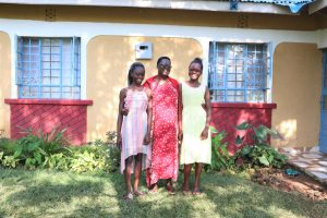 The Water Project:  Violet With Her Two Daughters In Front Of Their Home