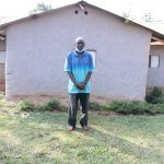 The Water Project: Shihingo Community, Inzuka Spring -  Gerald Inzuka In Front Of His House