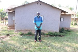 The Water Project:  Gerald Inzuka In Front Of His House