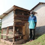 The Water Project: Shihingo Community, Inzuka Spring -  Gerald Next To His Poultrys House