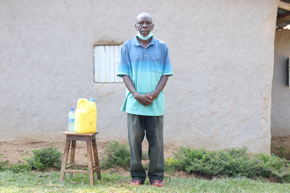 The Water Project : covid19-kenya19123-gerald-next-to-his-handwashing-station