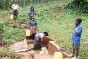 The Water Project:  Alice Fetching Water