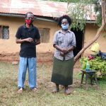 The Water Project: Hirumbi Community, Khalembi Spring -  Alice With Her Husband Outside Their House