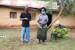 The Water Project:  Alice With Her Husband Outside Their House