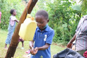 The Water Project:  Alices Son Baraka Washes His Hands