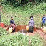 The Water Project: Hirumbi Community, Khalembi Spring -  Social Distancing At The Spring
