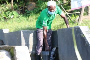 The Water Project:  Joshua Kusimba Fetching Water At The Spring