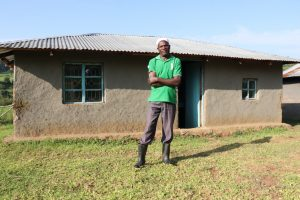 The Water Project:  Joshua Kusimba Outside His Home