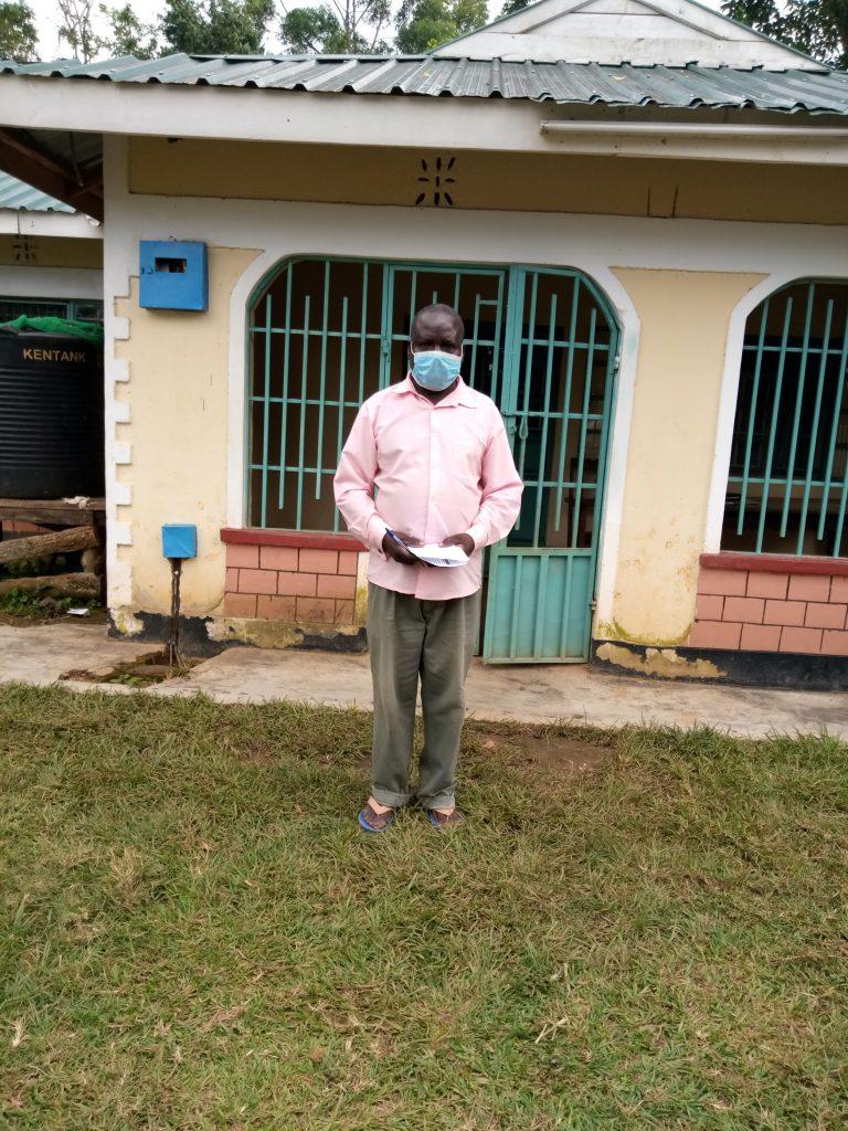 The Water Project : covid19-kenya43-ochango-william-wearing-a-face-mask