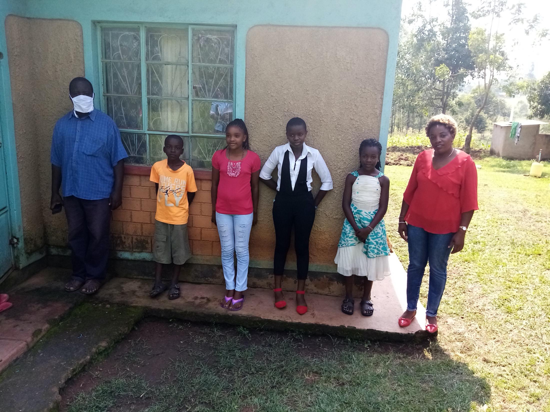 The Water Project : covid19-kenya4354-yeswa-peter-sabana-and-his-family