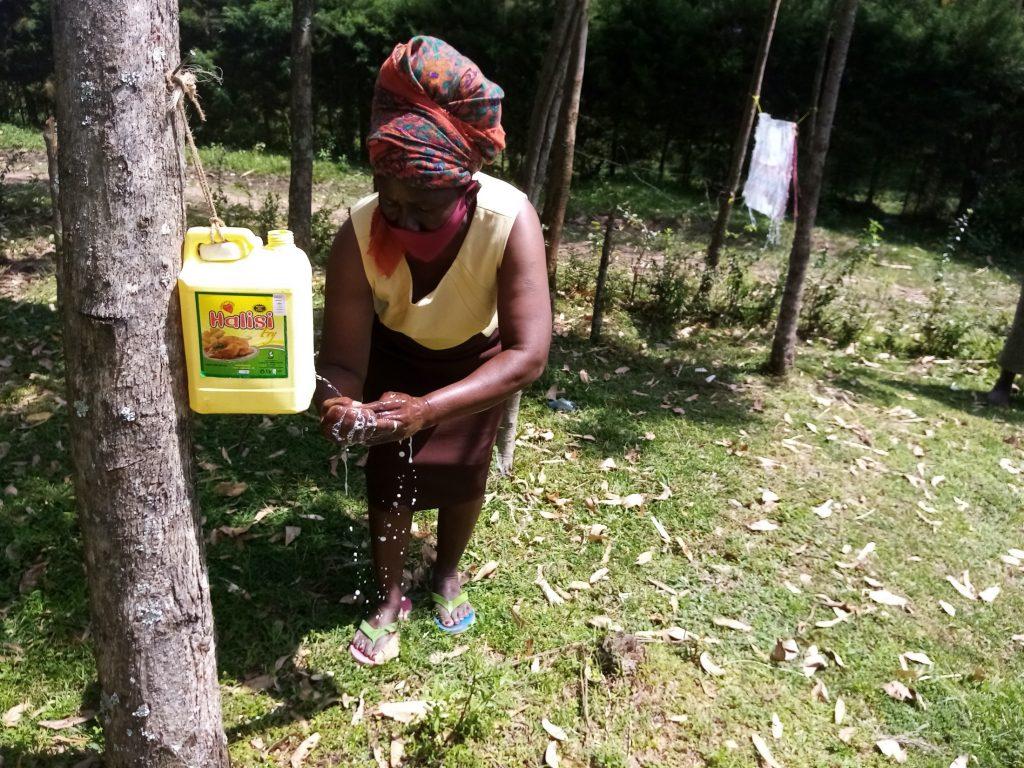The Water Project : covid19-kenya4360-mical-barasa-naliaka-at-her-handwashing-station