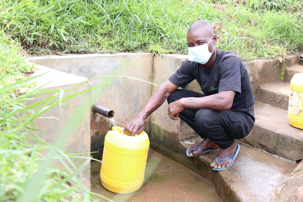 The Water Project : covid19-kenya4562-robert-fetches-water-from-robert-chemase-spring
