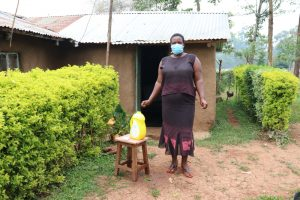 The Water Project:  Rosemary In Front Of Her House Next To The Handwashing Station