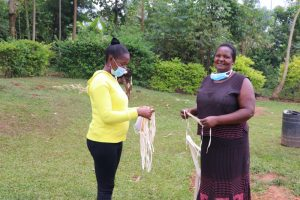 The Water Project:  Rosemary Receiving A Mask From Field Officer Christine At Training
