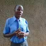The Water Project: Malinda Secondary School -  A Student Demonstrates Toothbrushing