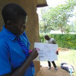 The Water Project: Malinda Secondary School -  A Student Uses Diagrams To Expound On Hygienic Ways