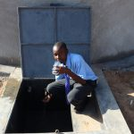 The Water Project: Malinda Secondary School -  Enjoying A Fresh Drink From The Rain Tank