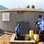 The Water Project: Malinda Secondary School -  Pupils Collecting Water