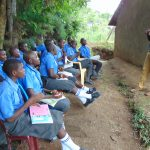 The Water Project: Malinda Secondary School -  Pupils Listen To Trainer Samuel