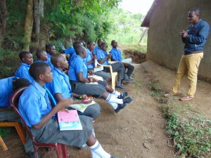 The Water Project:  Pupils Listen To Trainer Samuel