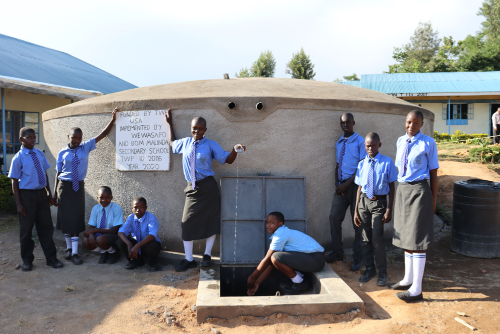 The Water Project : kenya20116-students-posing-at-the-finished-tank-1