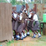The Water Project: Friends Kisasi Secondary School -  Girls Scram At The Latrines