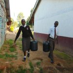 The Water Project: Friends Kisasi Secondary School -  Students Carrying Water