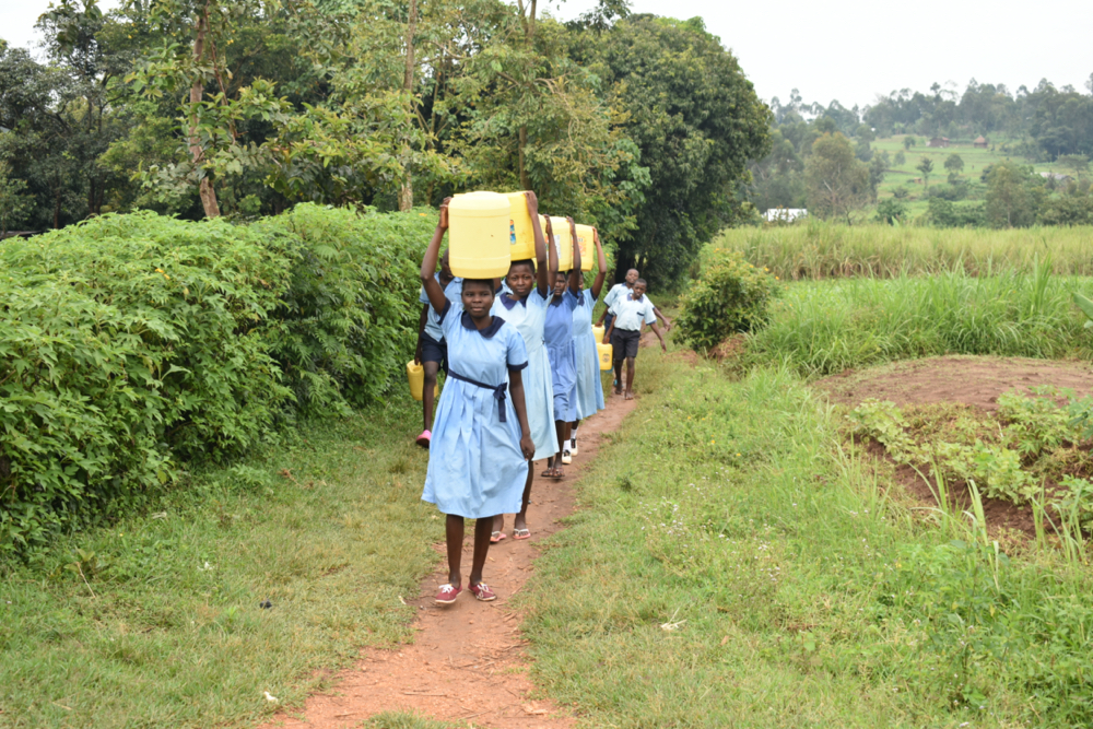 The Water Project : kenya20009-students-carrying-water-1