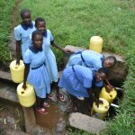 The Water Project: Isango Primary School -  Students Collecting Water At The Spring