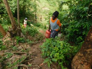 The Water Project:  Carrying Water Up The Steep Hill From The Spring
