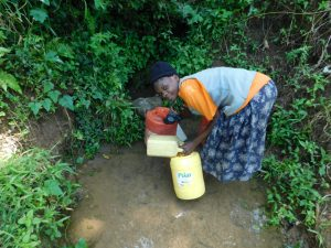 The Water Project:  Collecting Water From Lubale Spring