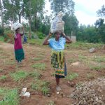 The Water Project: Kapkoi Primary School -  Women Deliver Rocks For Construction
