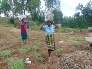 The Water Project:  Women Deliver Rocks For Construction