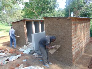 The Water Project:  Latrine Outside Plaster
