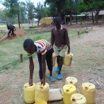 The Water Project: Boyani Primary School -  Before Schools Closed Students Helped Deliver Water For Construction