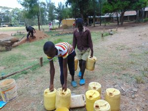 The Water Project:  Before Schools Closed Students Helped Deliver Water For Construction