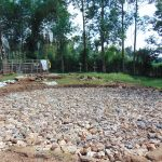 The Water Project: Boyani Primary School -  Foundation Layer Of Rocks And Wire