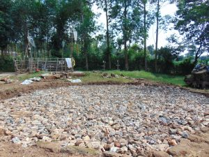 The Water Project:  Foundation Layer Of Rocks And Wire