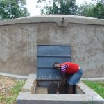 The Water Project: Boyani Primary School -  School Staff Member At The Rain Tank