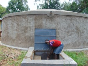 The Water Project:  School Staff Member At The Rain Tank