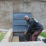 The Water Project: Boyani Primary School -  The Board Of Management Chair At The Rain Tank