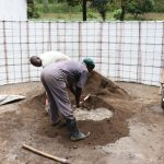The Water Project: Friends School Shivanga Secondary -  Mixing Plaster Inside The Tank