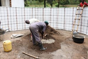 The Water Project:  Mixing Plaster Inside The Tank