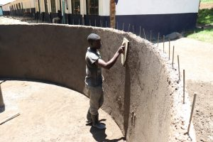 The Water Project:  Smoothing The Plaster Inside The Tank