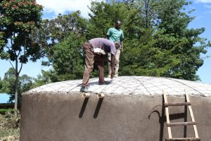 The Water Project:  Artisan Mr Evans Securing The Dome Frame